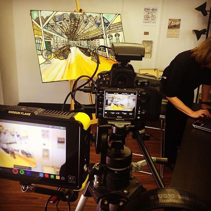 Video camera shooting video of art.